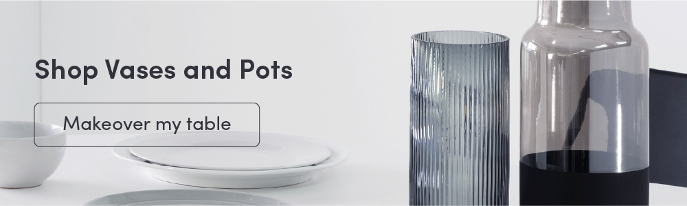 Shopping banner for vases and pots featuring a white dinner table and two glass vases